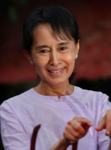 ** CORRECTS SPELLING OF MYANMAR **  Myanmar's pro democracy leader Aung San Suu Kyi addresses her supporters from her house compound after her release from house arrest in Yangon, Myanmar, Saturday, Nov 13, 2010.(AP Photo)